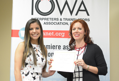Michelle Palafox, left, receives the Promising ITR Professional Scholarship from Jeana Clark, president of the Iowa Interpreters and Translators Association.