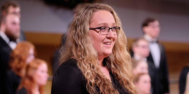 Student singing during Christmas Vespers