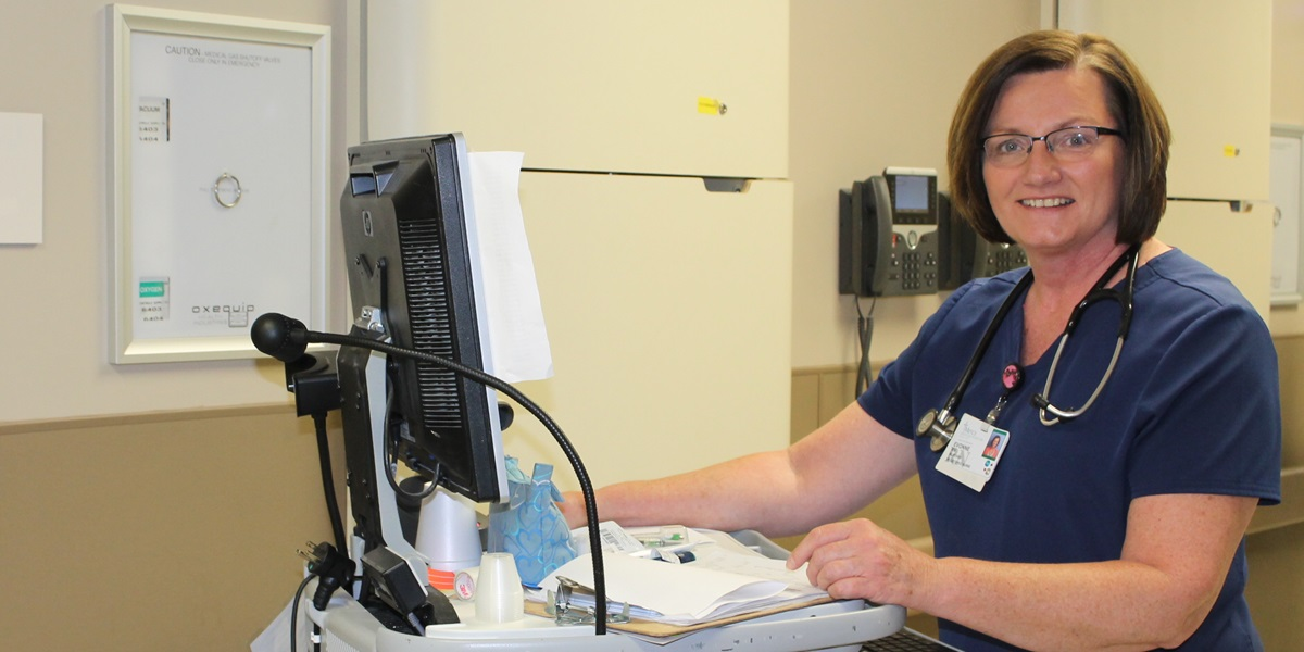 A two-time Northwestern graduate and cancer survivor, Evonne Blankers provides nursing care to patients at Mercy Medical Center.